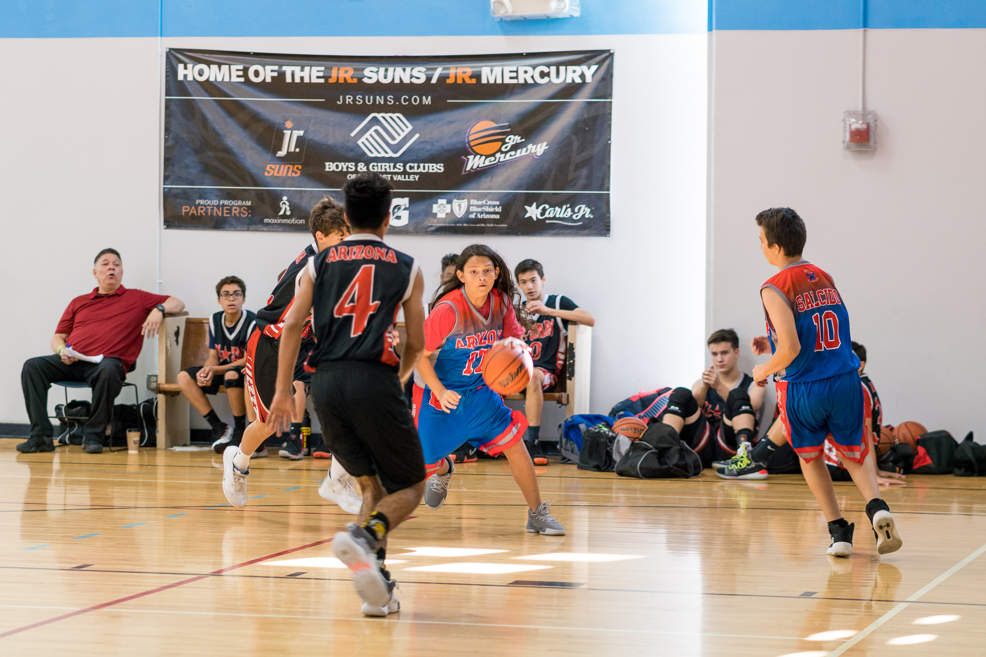East Valley basketball club Player playing defense